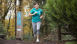 Y Staff person running trails