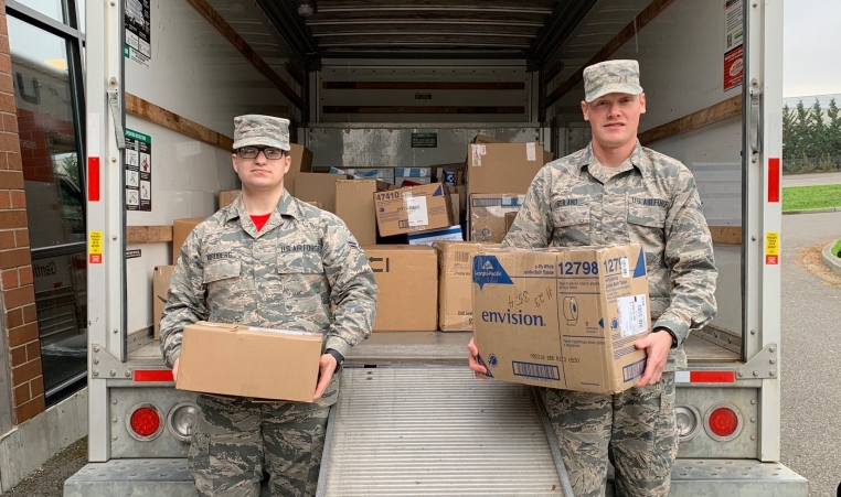 Troops receiving candy from YMCA's candy buy back program