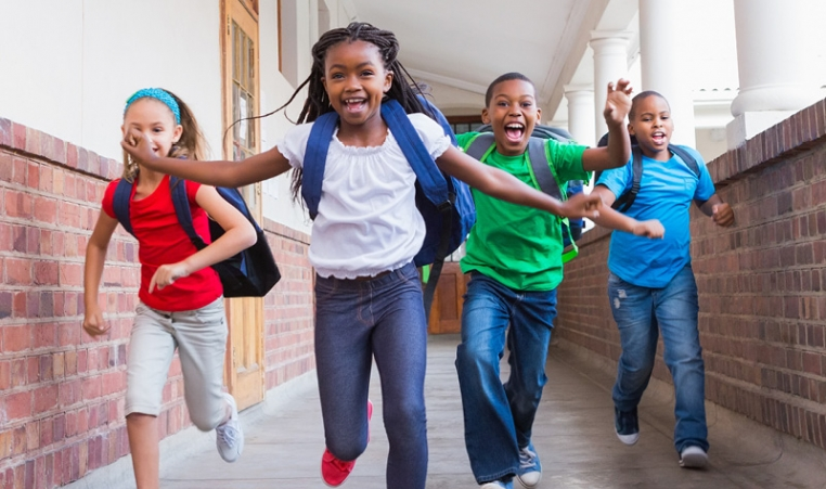 Kids laughing and running at school