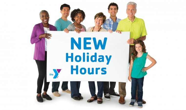 "Image of a group of people holding up a sign that says ""new holiday hours"""