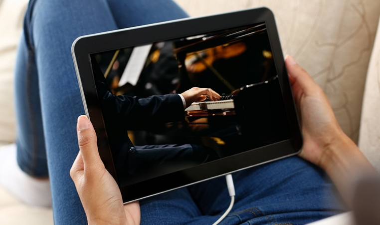 Watching a concert on an ipad, an example of one way to stay connected while social distancing