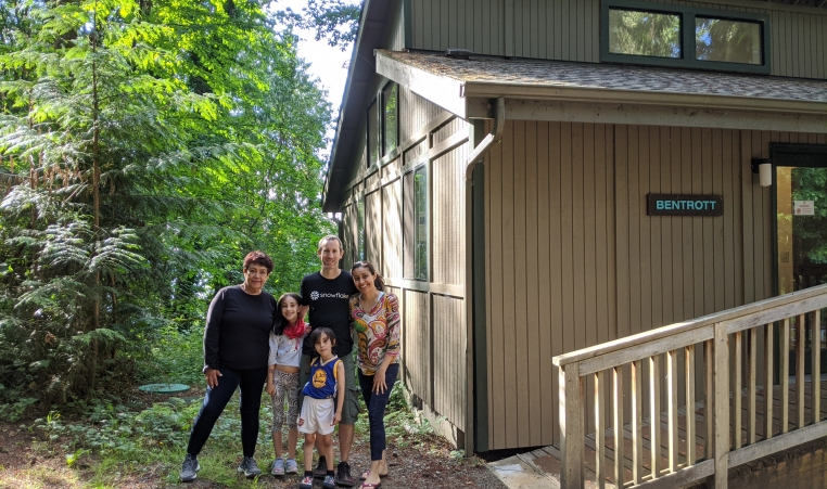Family posting next to cabin at Camp Colman