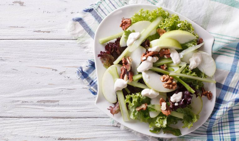 Salad featuring walnuts, apples, celery, lettuce, cheese