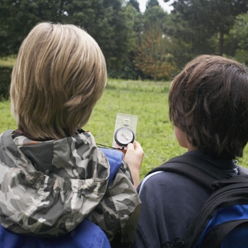 Two Kids using compasses