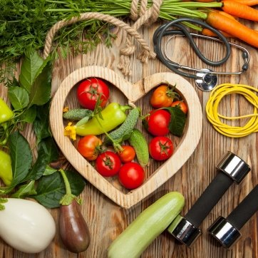 Fresh vegetables and workout equipment you can use to create new healthy habits