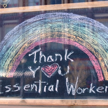 Rainbow drawn on chalk board thanking essential workers