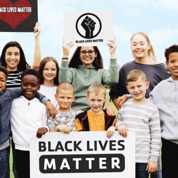 Group of diverse kids supporting the Black Lives Matter movement.