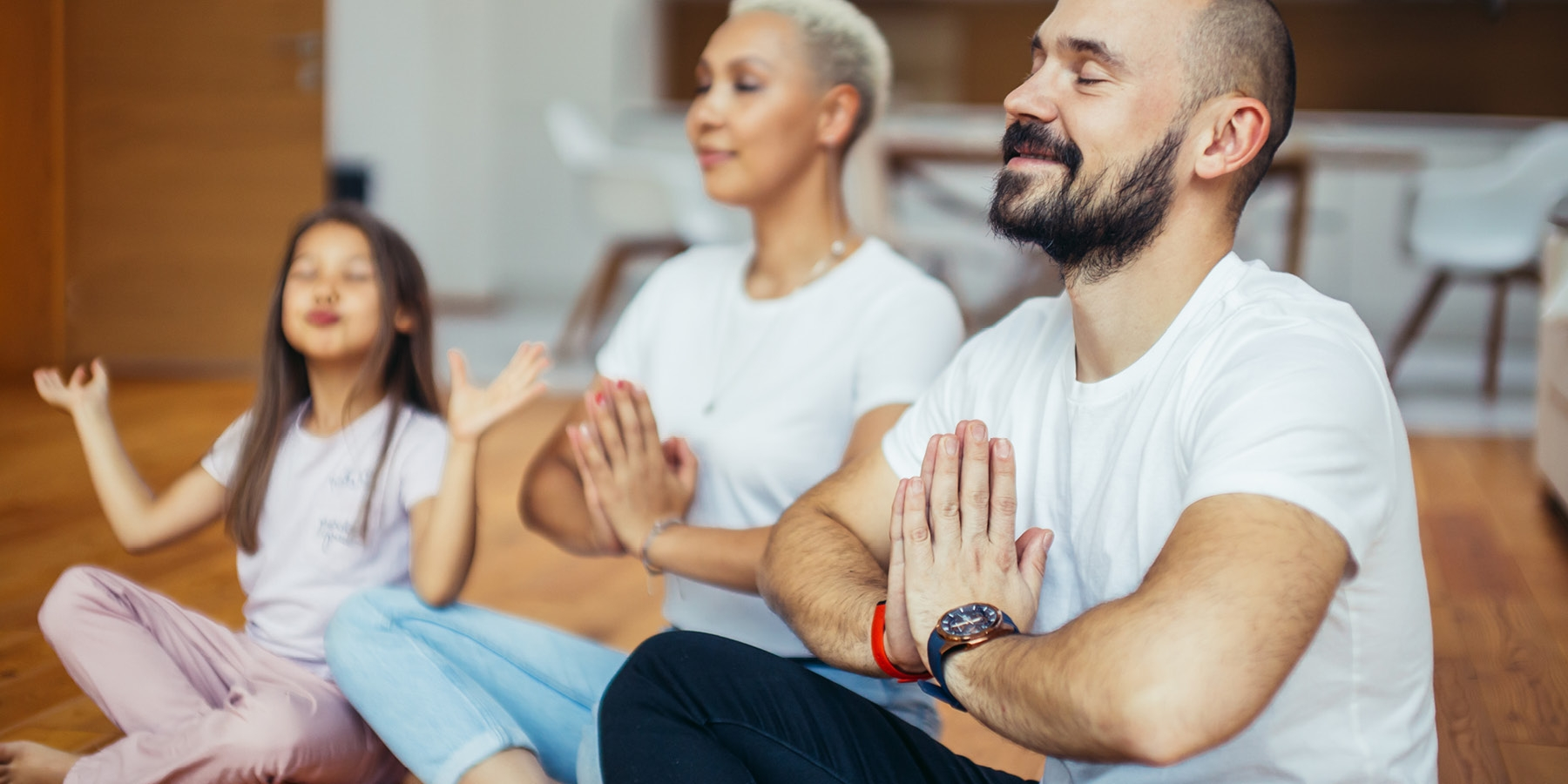 Family practicing meditation together