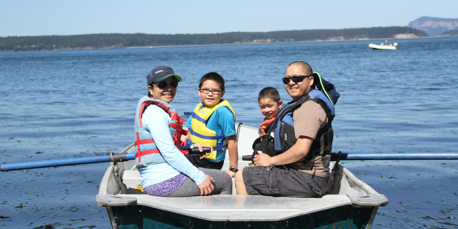 Family on boat at water's edge
