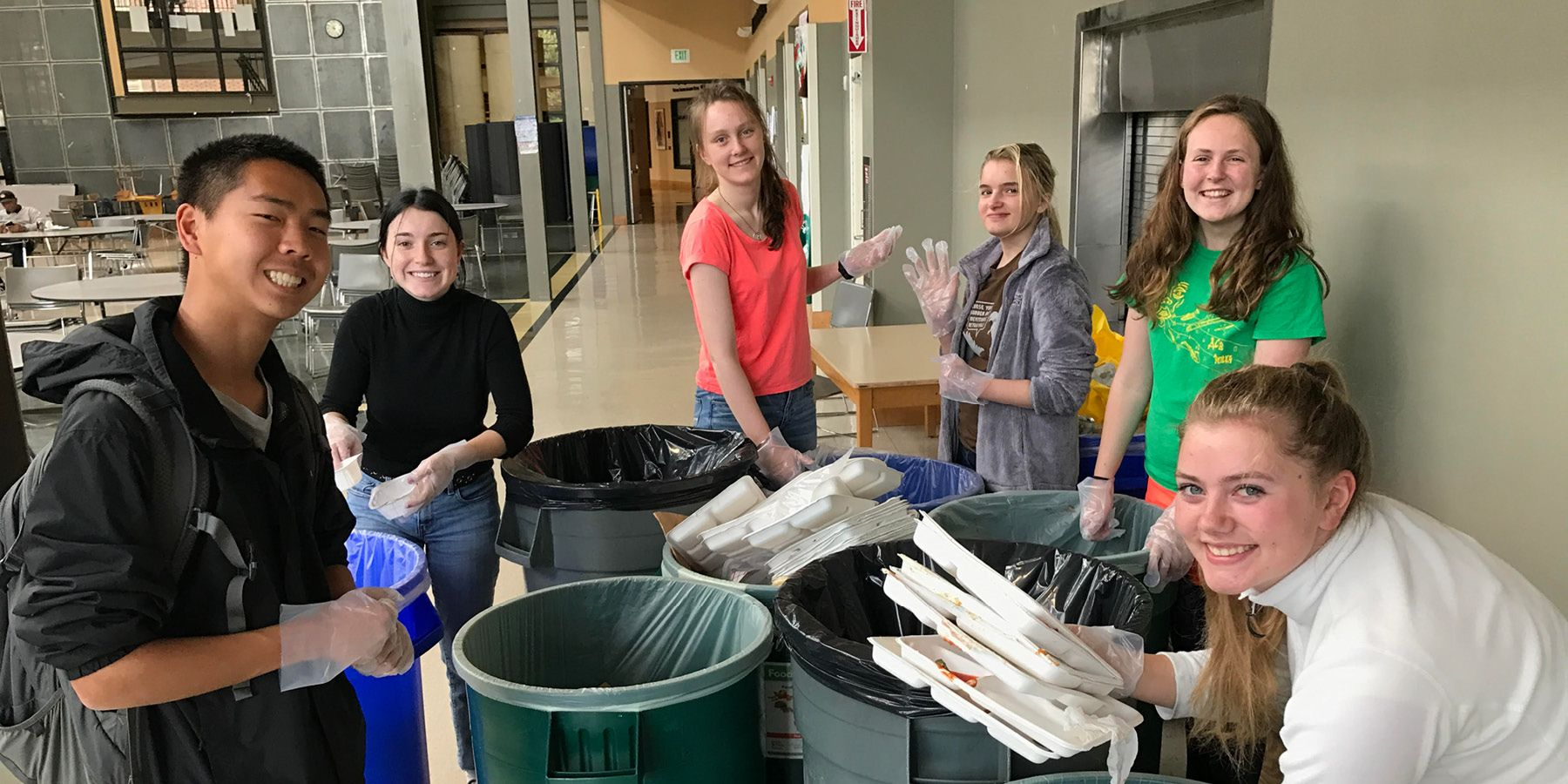 Group of high school students separating trash at their school