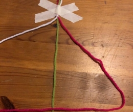 Visual representation of step 4 of making a friendship bracelet.
